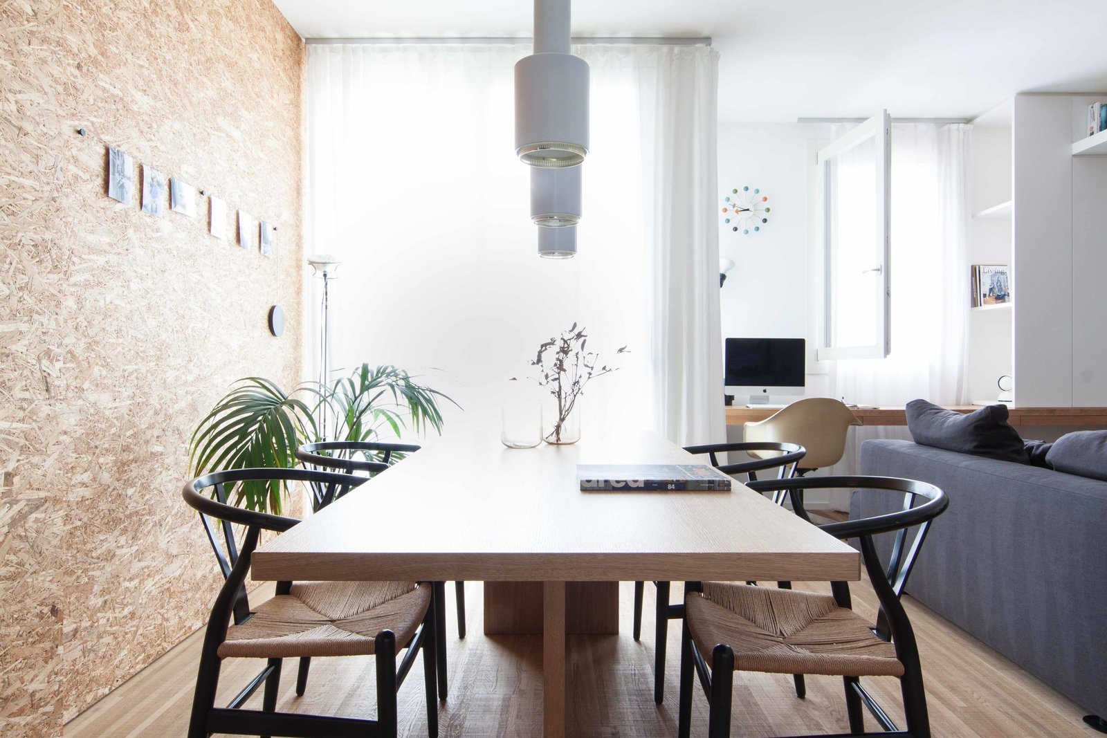 Tagged: Dining Room, Table, Medium Hardwood Floor, Pendant Lighting, and Chair.  Interior LP by Didonè Comacchio