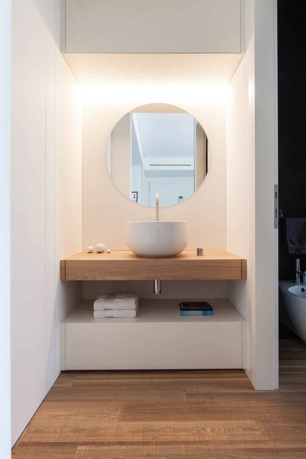Tagged: Bath Room, Wood Counter, Vessel Sink, Enclosed Shower, Medium Hardwood Floor, Ceiling Lighting, and One Piece Toilet.  Interior LP by Didonè Comacchio