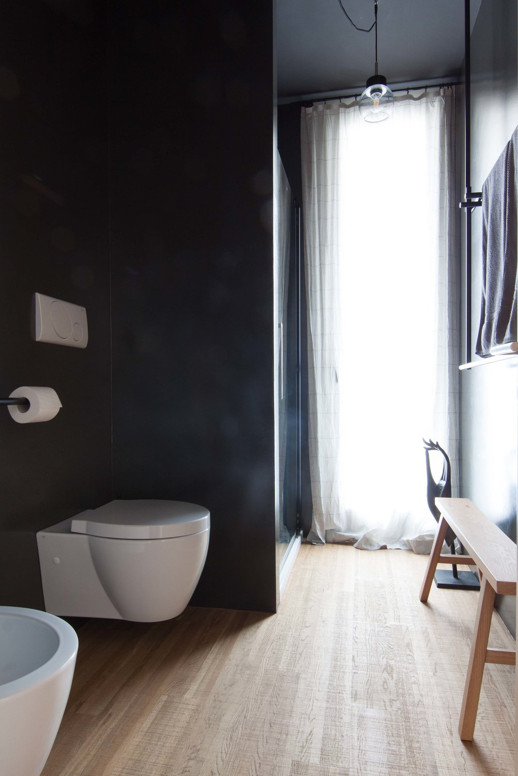 Tagged: Bath Room, Medium Hardwood Floor, Pendant Lighting, Enclosed Shower, Concrete Wall, and One Piece Toilet.  Interior LP by Didonè Comacchio
