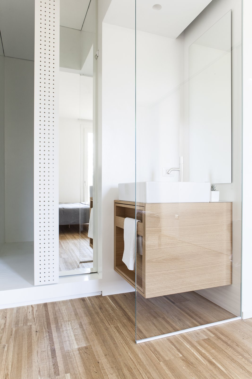 Tagged: Bath Room, Medium Hardwood Floor, Wood Counter, Vessel Sink, Full Shower, Ceiling Lighting, Concrete Wall, Wall Lighting, and One Piece Toilet.  Interior LP by Didonè Comacchio