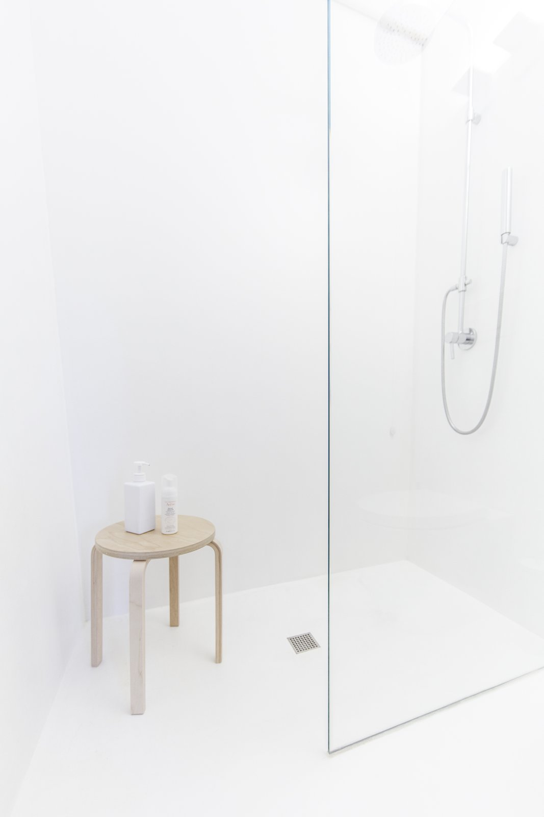 Tagged: Bath Room, Wood Counter, Concrete Floor, Vessel Sink, Full Shower, Ceiling Lighting, Concrete Wall, Wall Lighting, and One Piece Toilet.  Interior LP by Didonè Comacchio