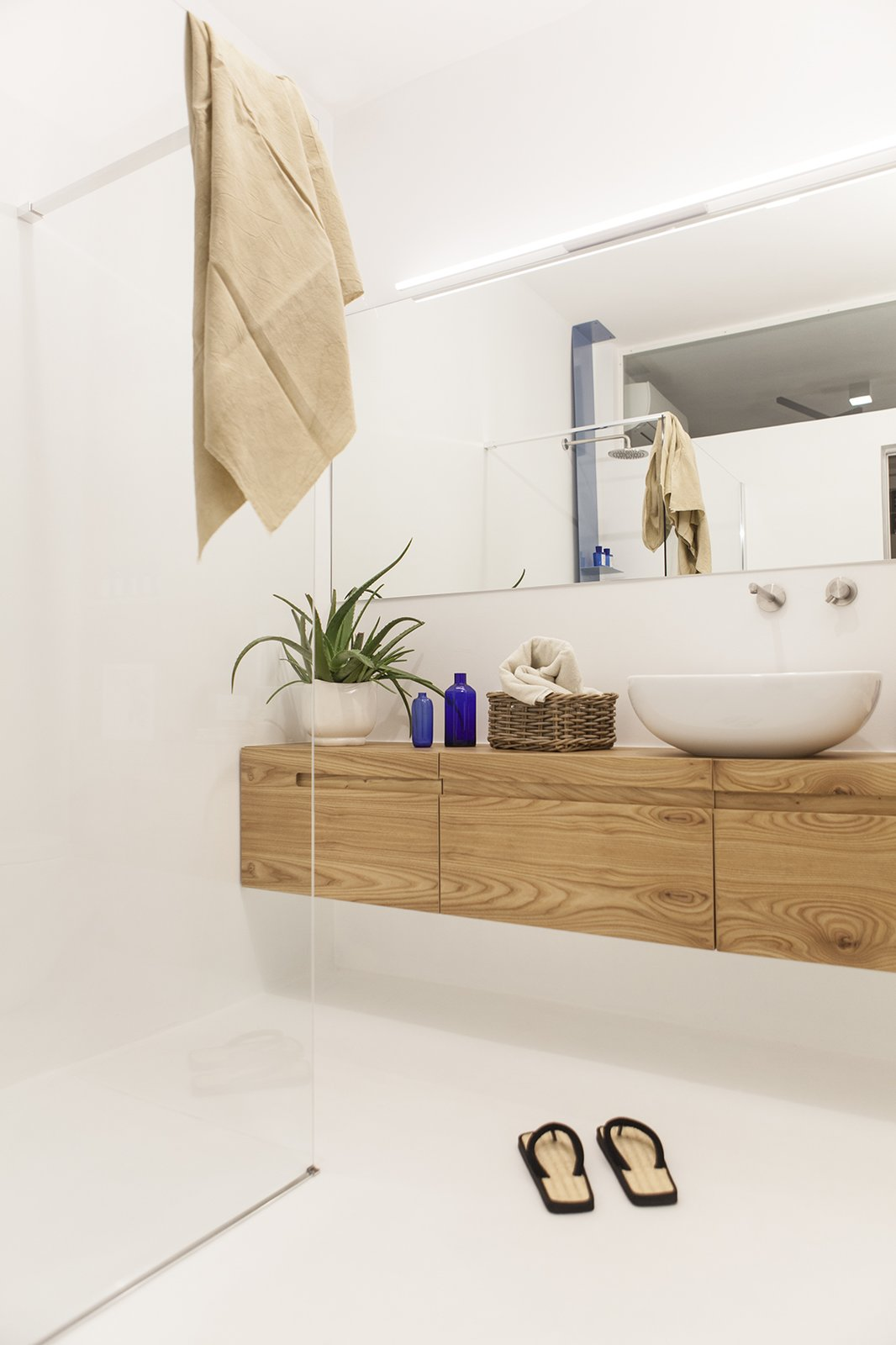 bathroom Tagged: Bath Room, Wall Lighting, One Piece Toilet, and Open Shower. Iterior DM by Didonè Comacchio