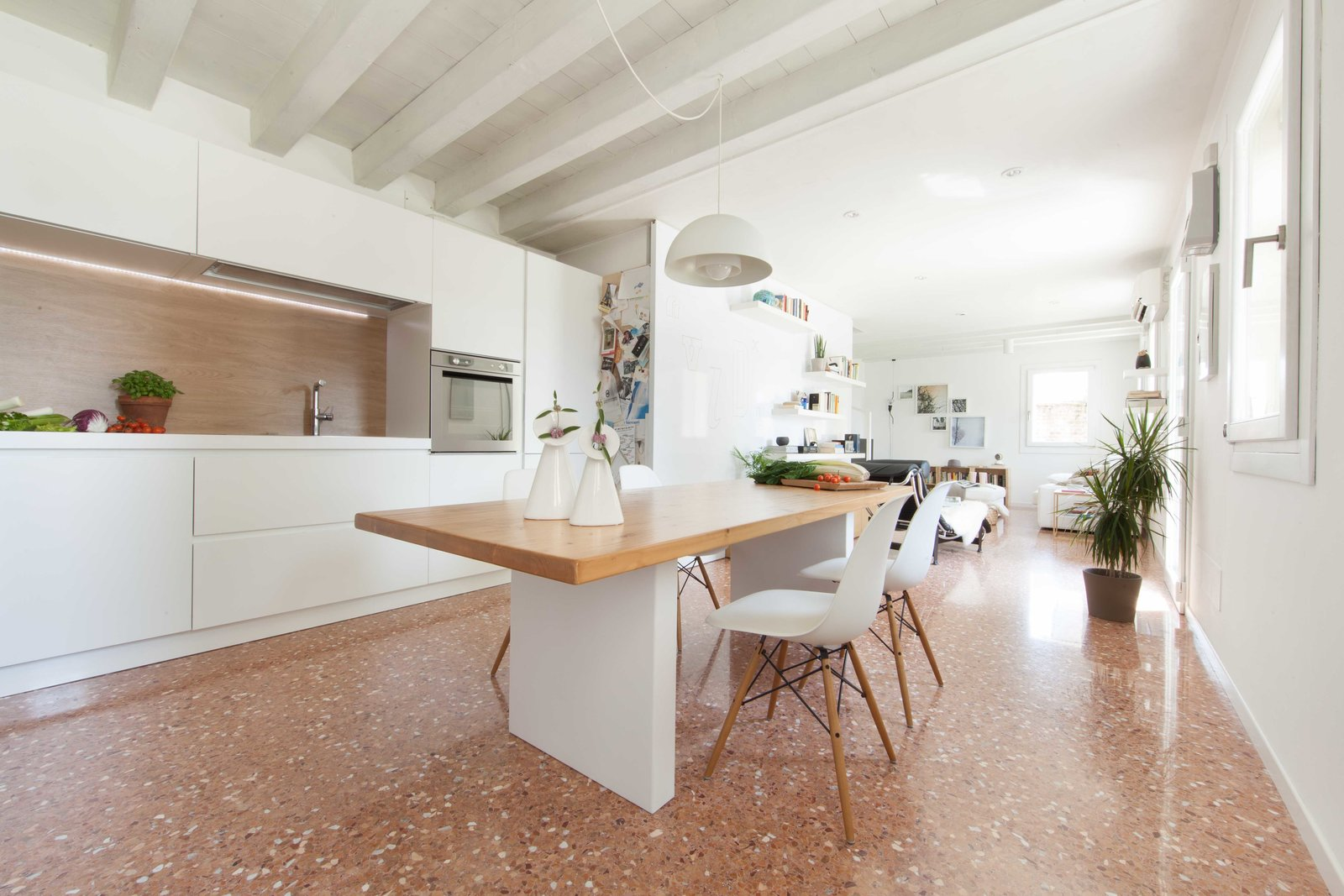 kitchen Tagged: Kitchen, White Cabinet, Pendant Lighting, and Marble Floor.  House PB by Didonè Comacchio