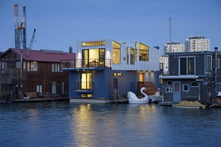 A New Book For Those Who Dream of Living in a Floating Home - Photo 5 of 11 - Paying homage to San Francisco's industrial history, this floating home by Robert Nebolon incorporates metal siding, a sawtooth roof, and warehouse-style window casements on the exterior. Inside, the three-level, 2,100-square-foot home has an open and flowing floor plan on the top floor, where the living areas are located. The middle and lower floors hold the bedrooms, bathrooms, and storage areas.