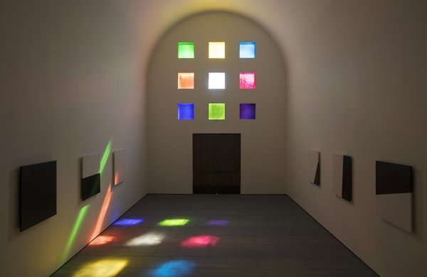 Inside the sun shines through the colorful stained glass windows.