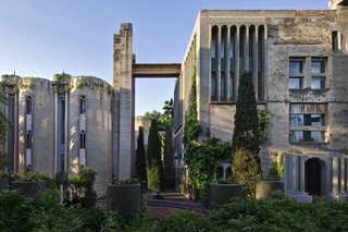 A Spanish Architect Converts a Cement Factory Into a Breathtaking Home and Headquarters - Photo 1 of 12 - The exterior of Ricardo Bofill Taller de Arquitectura's headquarters features rugged concrete and climbing greenery.