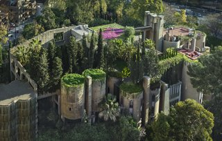 A Spanish Architect Converts a Cement Factory Into a Breathtaking Home and Headquarters - Photo 2 of 12 - A lush espalier covers the concrete walls of the Ricardo Bofill Taller de Arquitectura headquarters.