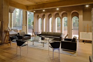 A Spanish Architect Converts a Cement Factory Into a Breathtaking Home and Headquarters - Photo 4 of 12 - With its lofty ceilings, the cathedral is home to a conference and exhibition room.