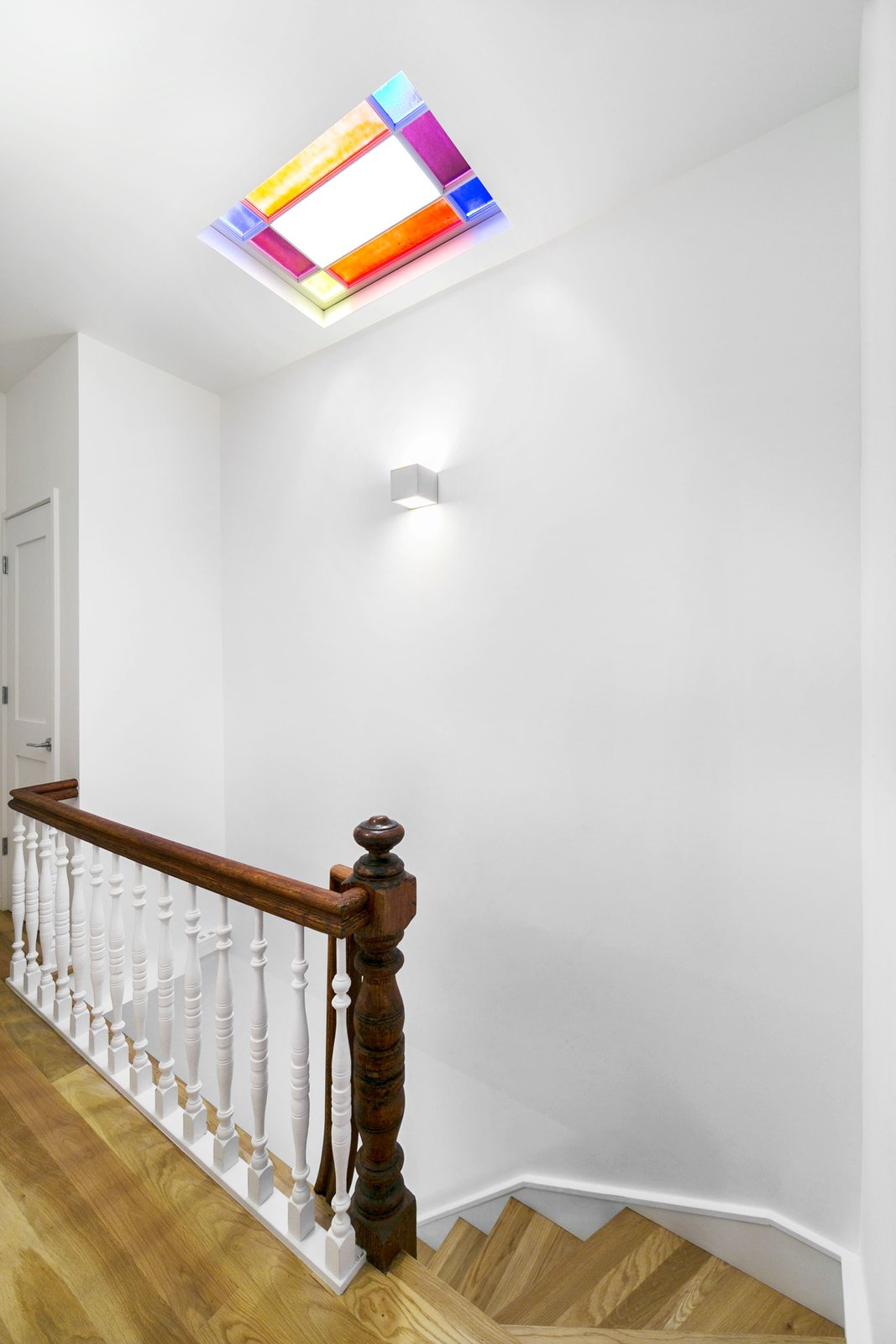 A restored stained glass skylight above the main staircase.
