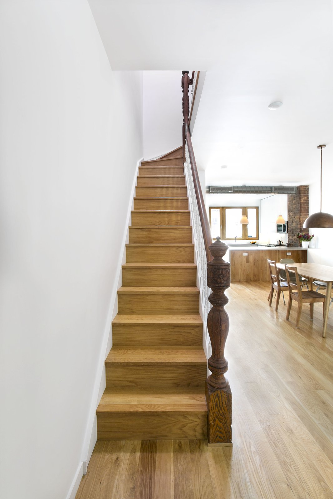 Stairs from parlor floor to second floor, with original railing. Tagged: Staircase, Wood Railing, and Wood Tread.  Sunset Park Row House by Ula Bochinska