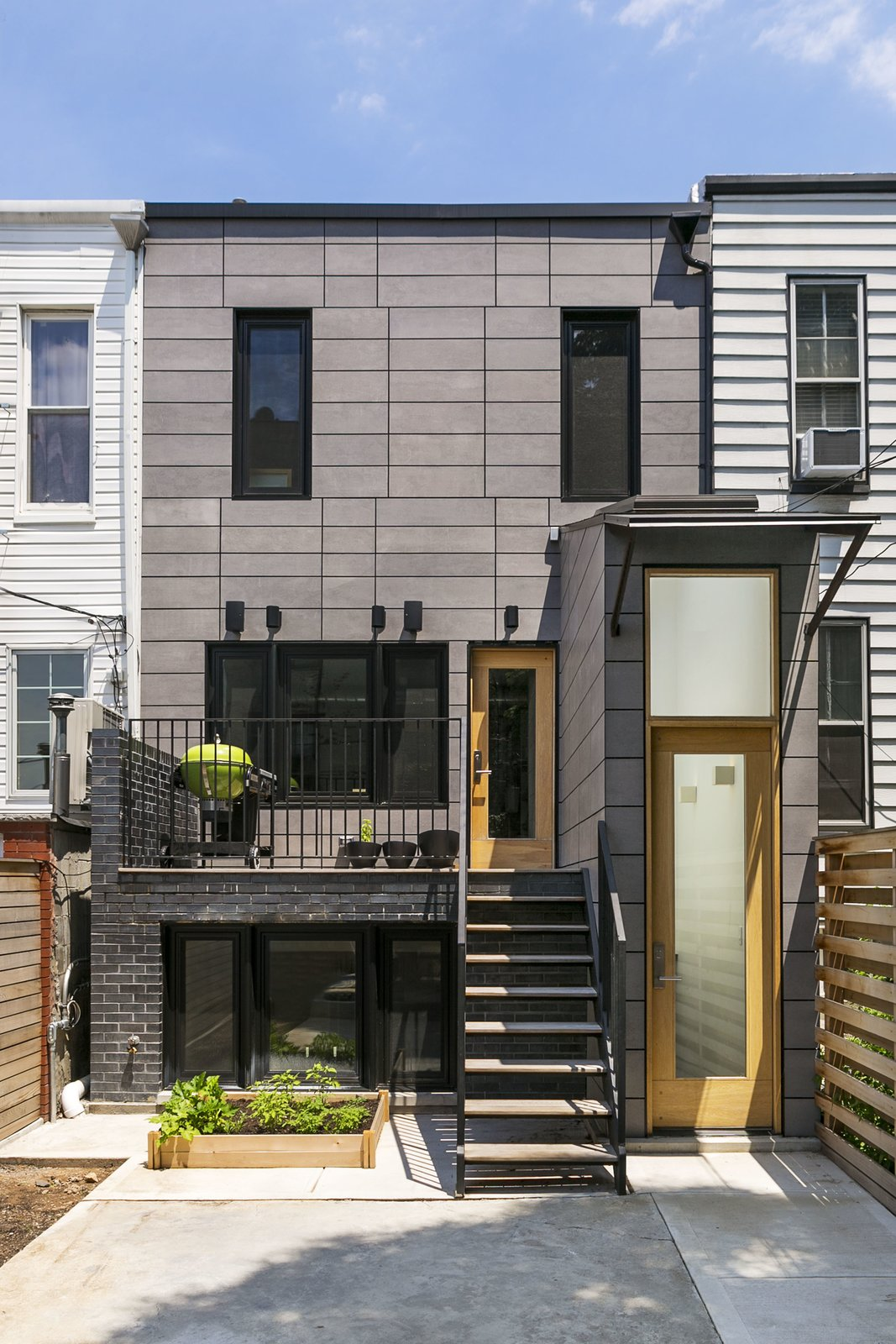 The rear facade. Tagged: Outdoor, Back Yard, Hardscapes, Small Patio, Porch, Deck, Wood Patio, Porch, Deck, and Vertical Fences, Wall.  Sunset Park Row House by Ula Bochinska
