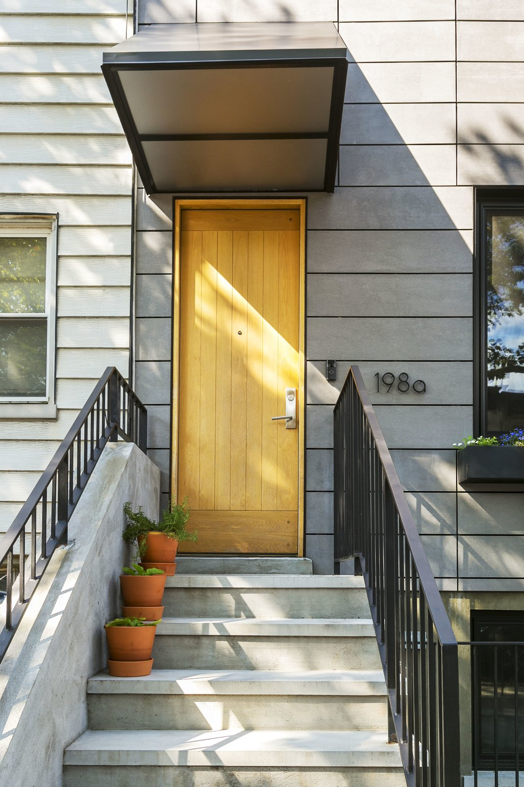 The main entry with custom awning. Tagged: Outdoor and Front Yard.  Sunset Park Row House by Ula Bochinska