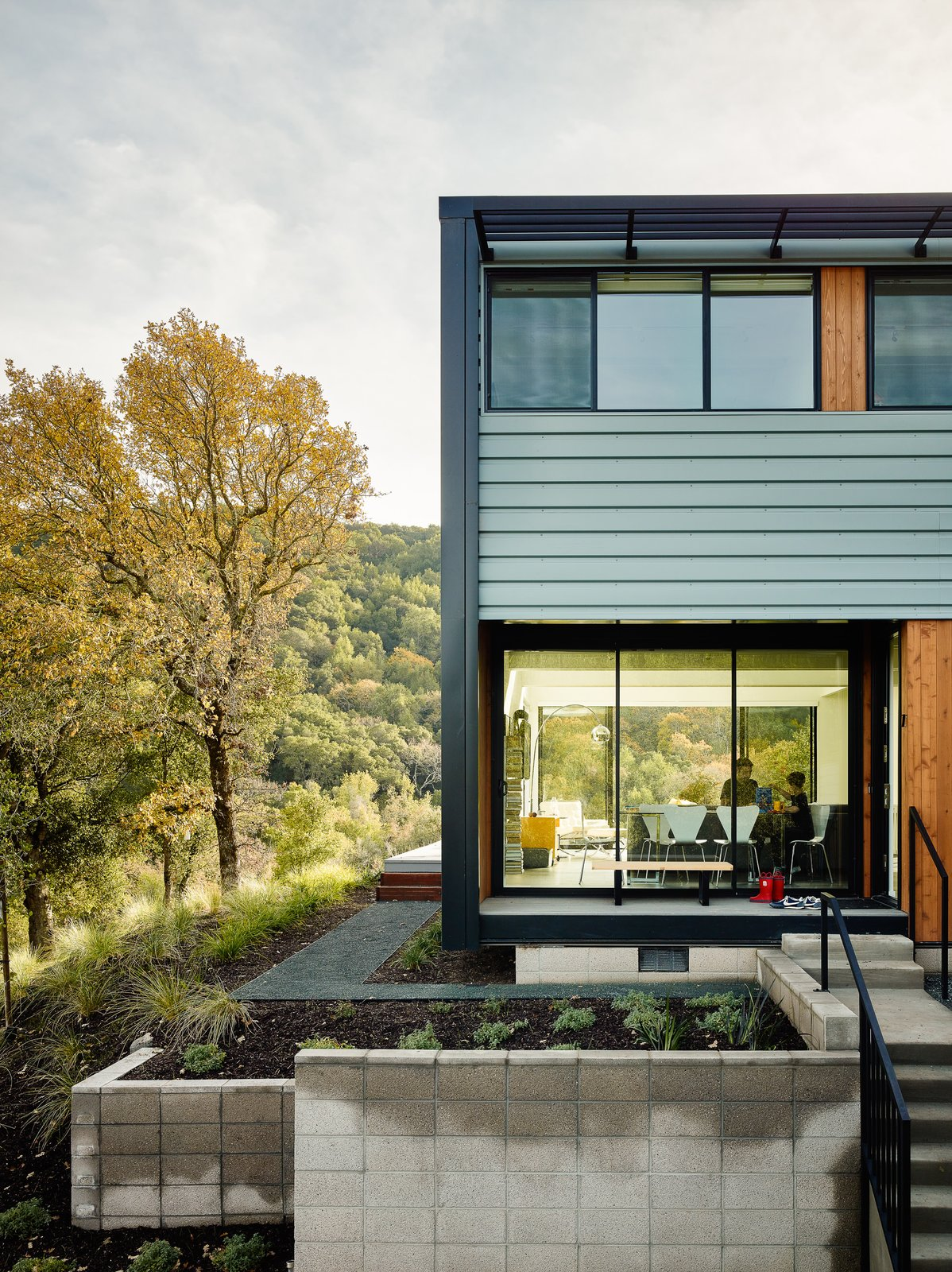 The numerous sliding windows also provide the option of passive cooling and an open-air kitchen, living area, and dining area.