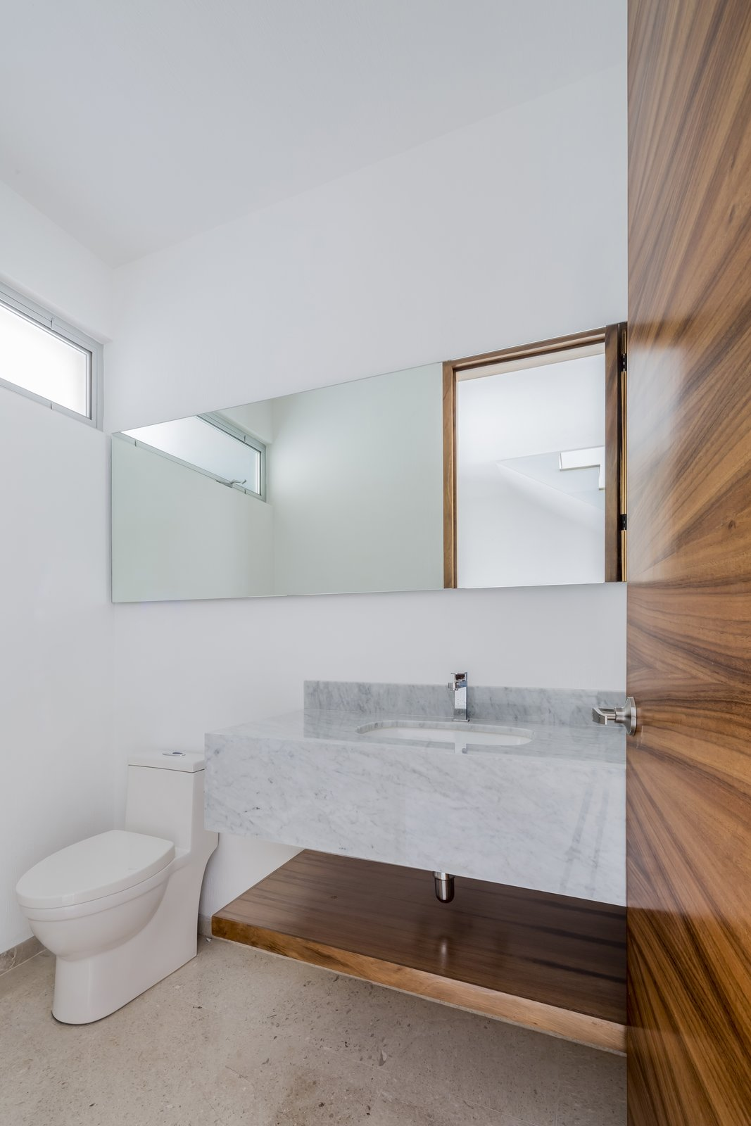 Tagged: Bath Room, Marble Counter, Marble Floor, Ceiling Lighting, and One Piece Toilet.  CASA VALLE by Sergio Villalobos