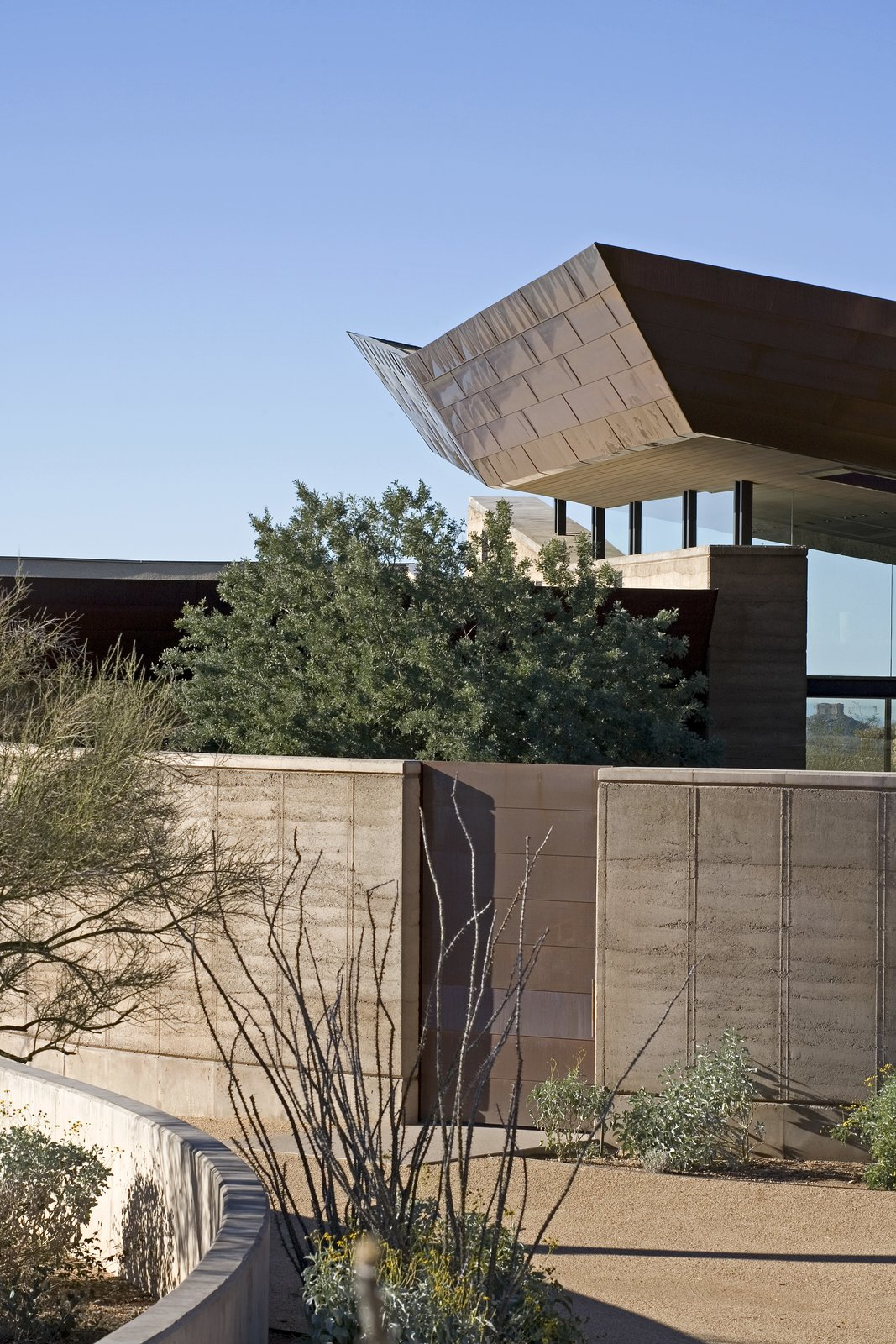 Tagged: Exterior, Metal Roof Material, Concrete Siding Material, House, and Metal Siding Material. Desert Wing by Brent Kendle