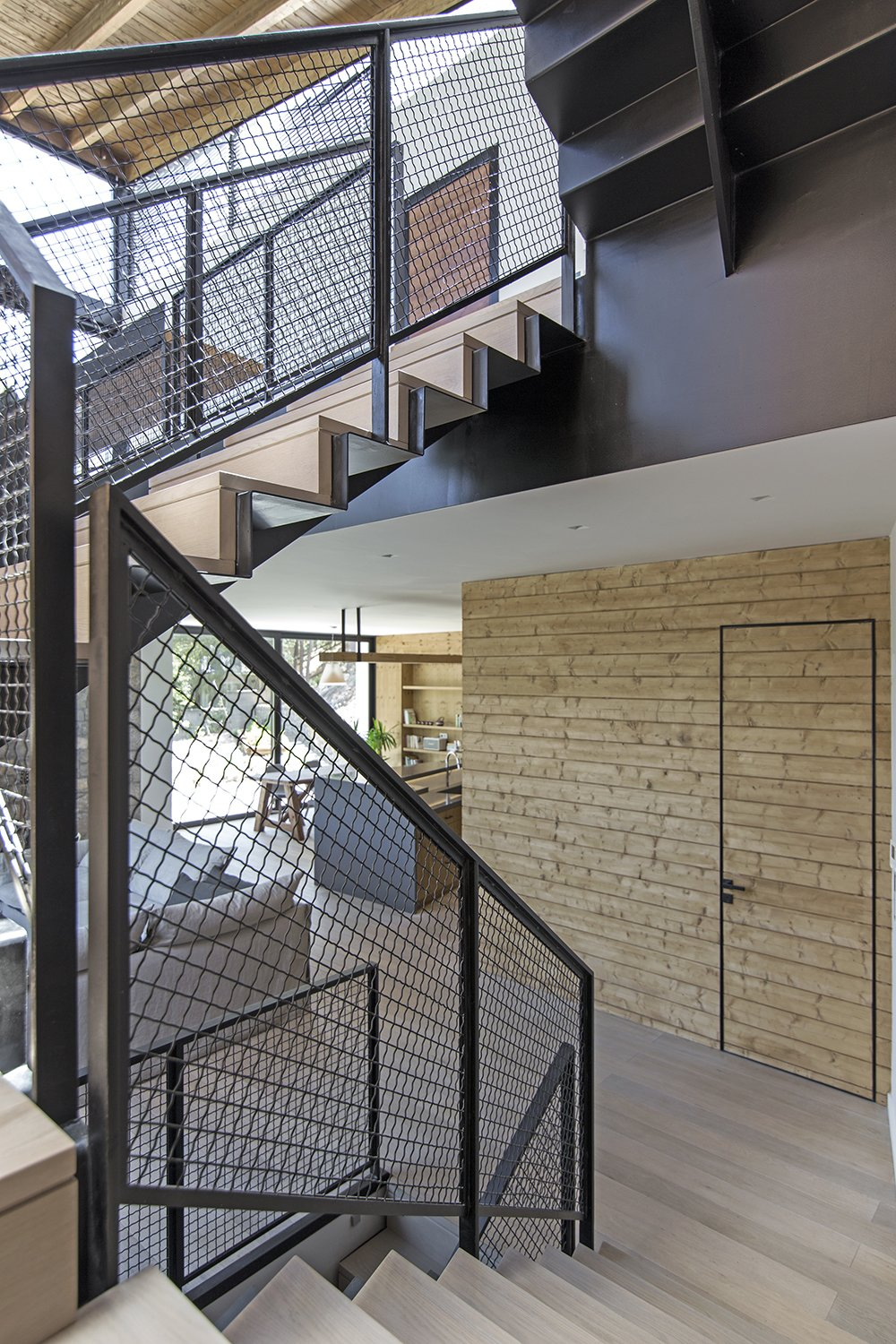 All finishes appear in their natural state Tagged: Staircase, Metal Tread, and Metal Railing.  The Wedge House by Marianna Athanasiadou