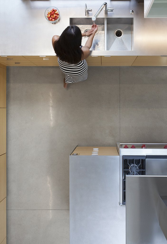 polished concrete floors and stainless steel countertops