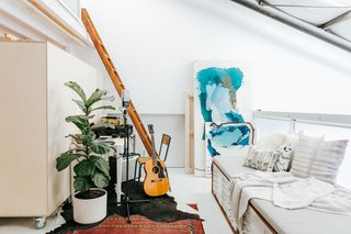 "This Three-Level Loft in San Francisco Is an Artist's Sanctuary - Photo 5 of 9 - ""There's an interesting form of communication that happens when we're both working. The music that is coming from the second floor starts to inform the painting that is happening on the first floor, and visa versa. It's like we're collaborating in an indirect way."""