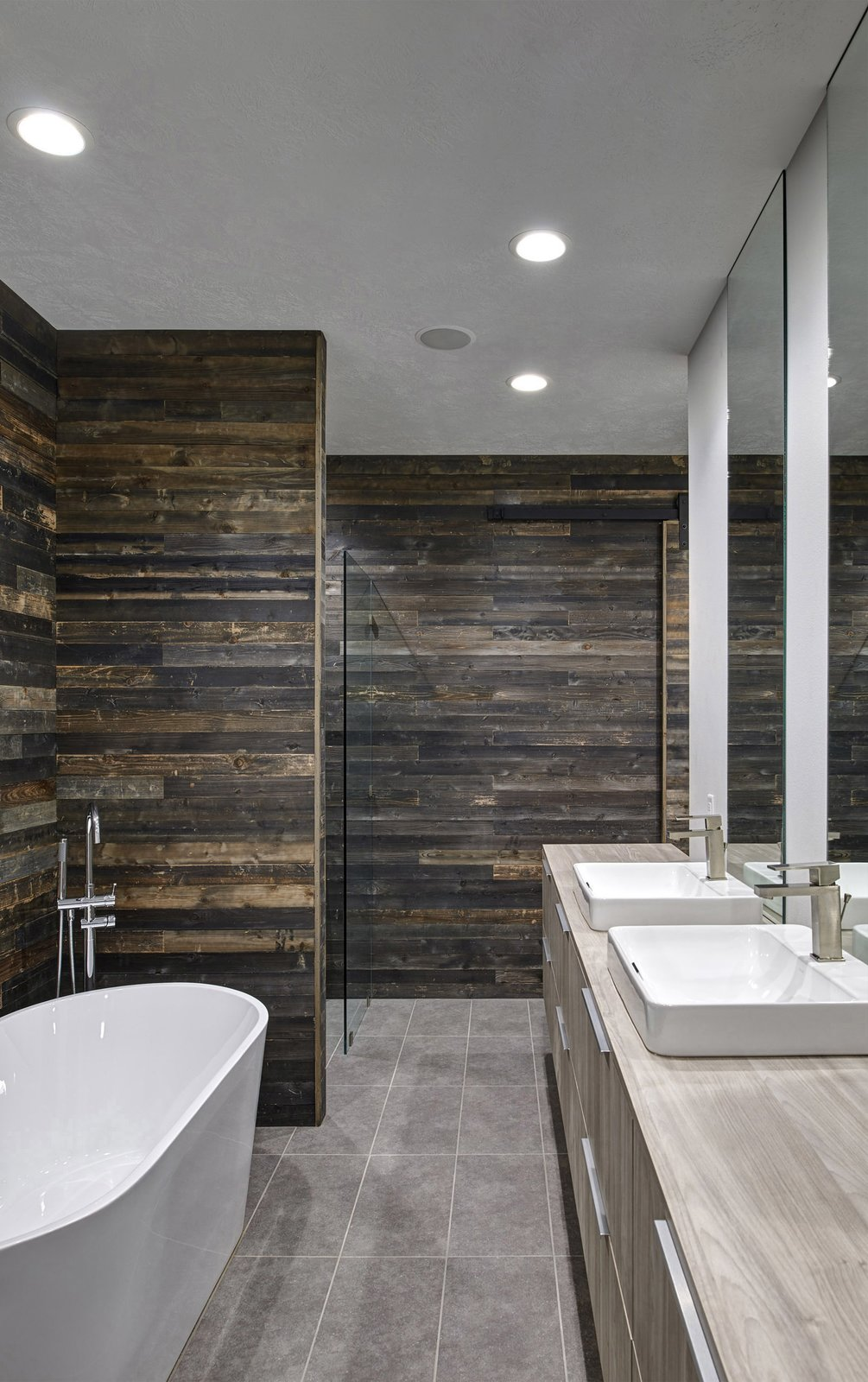 View showing the guest bathroom with formerly-exterior  cedar-sheathed walls. (2017) Tagged: Bath Room, Wood Counter, Laminate Counter, Ceramic Tile Floor, Vessel Sink, Freestanding Tub, Full Shower, and Recessed Lighting.  530 house by Nathan Kalaher