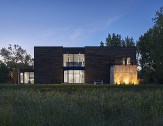 Discover 6 Amazing Riverside Homes - Photo 7 of 12 - PLaN Architecture designed this home to create connections and separations from the outlying prairie of South Dakota. The plan was to craft spaces that would be open and inviting, and others that would be secluded and private, despite the flat landscape.