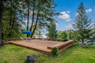 A Waterfront Washington Home Designed by a Renowned Spokane Architect Is Listed For $675K - Photo 3 of 10 -
