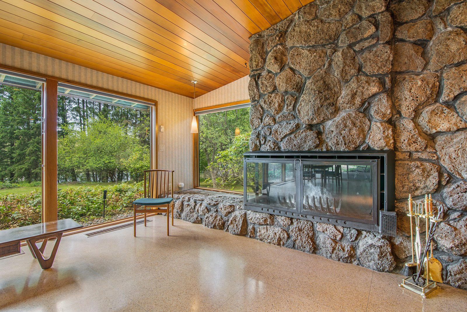Tagged: Living Room, Corner Fireplace, and Terrazzo Floor.  Photo 11 of 11 in A Waterfront Washington Home Designed by a Renowned Spokane Architect Is Listed For $675K