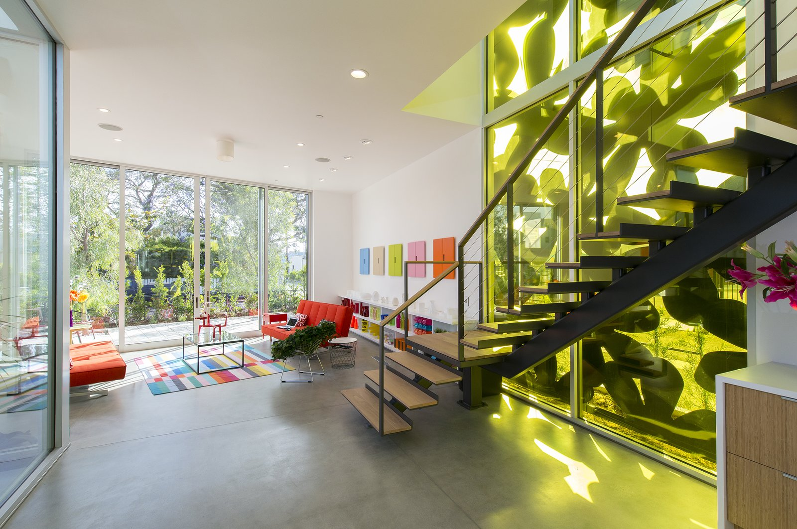 Stair with yellow-filtered light through facade Tagged: Concrete Floor, Ceiling Lighting, Staircase, Metal Railing, and Wood Tread.  Best Photos from 4016 Tivoli