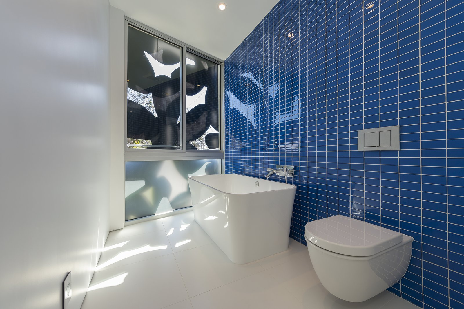 Glass-tile and porcelain bathroom Tagged: Bath Room, Porcelain Tile Floor, Vessel Sink, Freestanding Tub, Ceiling Lighting, Glass Tile Wall, One Piece Toilet, and Open Shower.  Best Photos from 4016 Tivoli