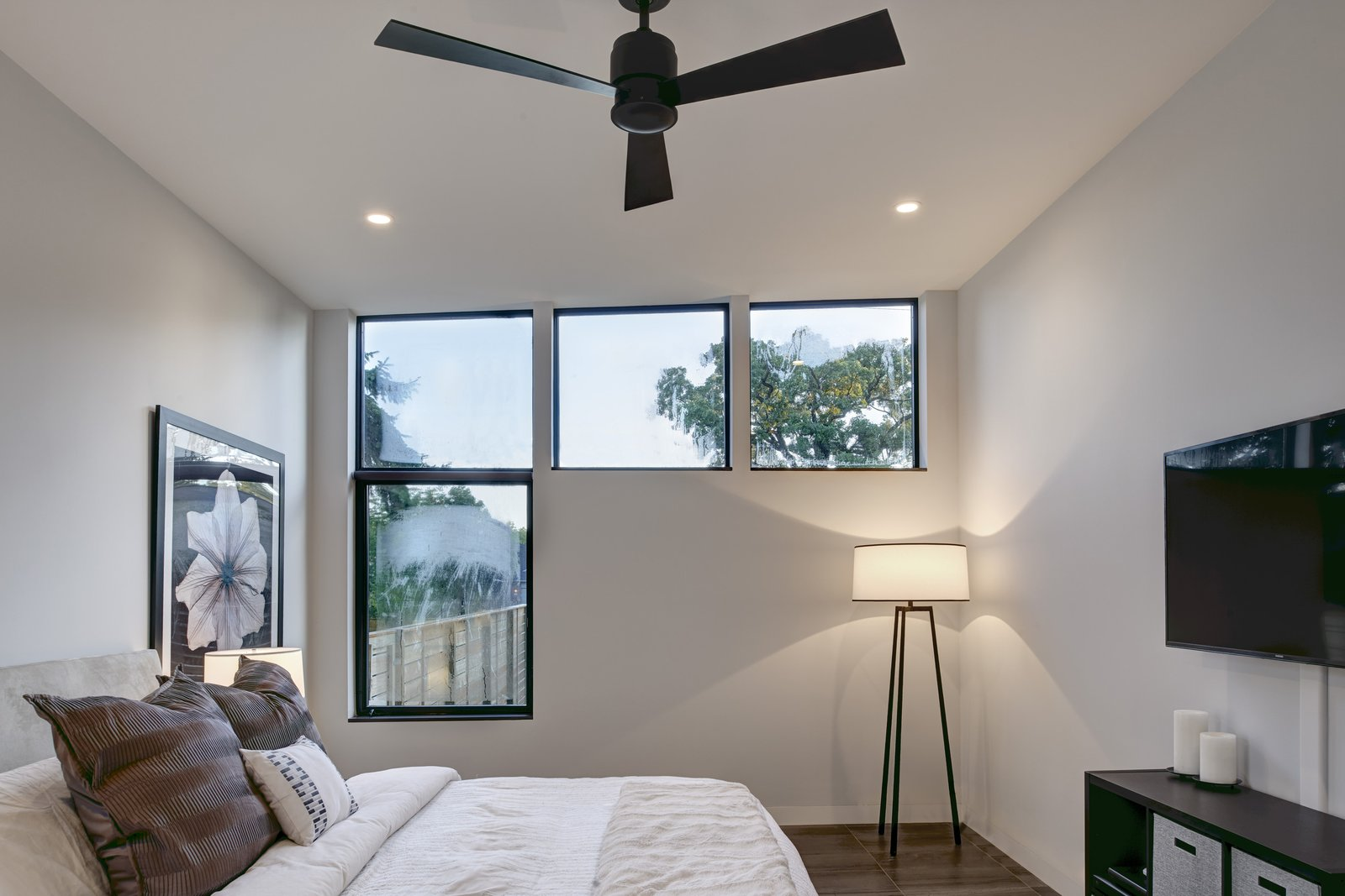 Reconfigured windows maximize daylight in the bedrooms. Tagged: Bedroom, Bed, Lamps, Shelves, Storage, Ceiling Lighting, Recessed Lighting, and Porcelain Tile Floor. 328 Koser by Neumann Monson Architects