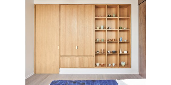 Guest bedroom rift & quartered oak closet, display shelving and door to storage.