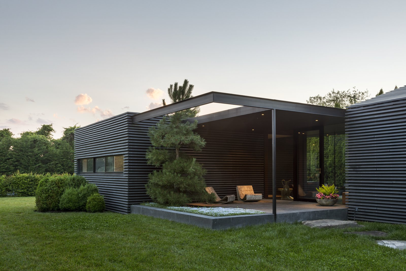 Tagged: Outdoor, Front Yard, Grass, Walkways, Gardens, Trees, Small Patio, Porch, Deck, Stone Patio, Porch, Deck, and Planters Patio, Porch, Deck.  Black House by Oza/Sabbeth Architecture