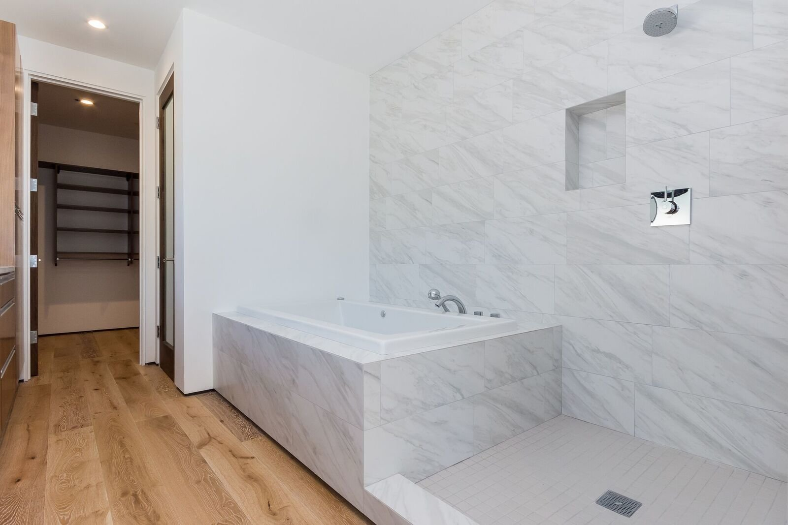 Master Bath with dual shower heads including rain head / jet tub Tagged: Bath, Medium Hardwood, Quartzite, Undermount, Drop In, Whirlpool, Full, Enclosed, Ceiling, Porcelain Tile, and One Piece.  Best Bath Enclosed Quartzite Photos from Mammoth Modern House 1