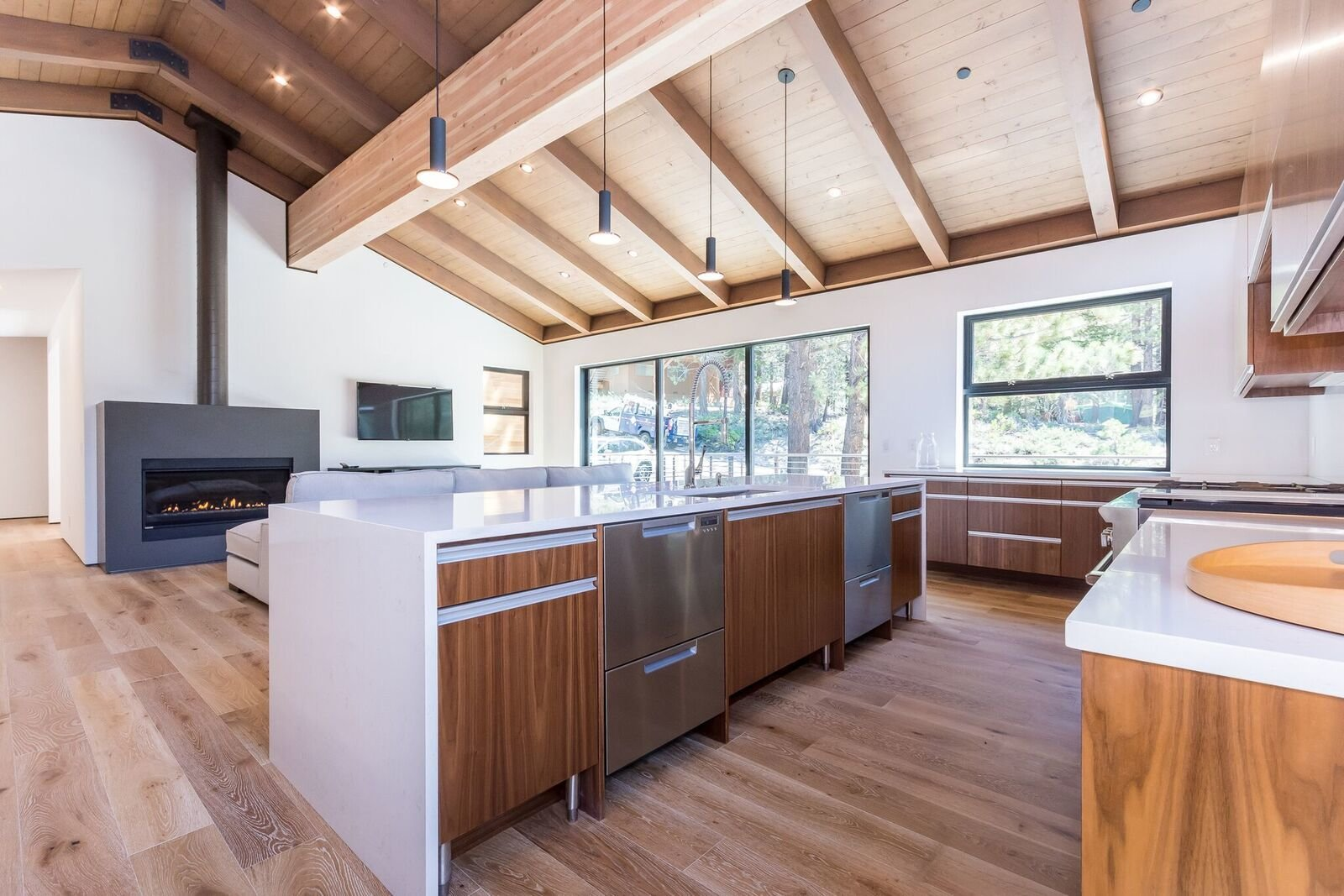 Dual dishdrawer units for holidays, large dinners, friends... Tagged: Kitchen, Quartzite Counter, Engineered Quartz Counter, Wood Cabinet, Ceiling Lighting, Pendant Lighting, Dishwasher, Undermount Sink, and Medium Hardwood Floor.  Mammoth Modern House 1 by Amy Kramer
