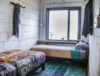 Modern home with Bedroom, Bed, Bookcase, Storage, Shelves, Night Stands, and Wardrobe. This rug was handpicked by Matt in India and really opens up an inviting room in Houze II Photo 8 of FLOPHOUZE Hotel