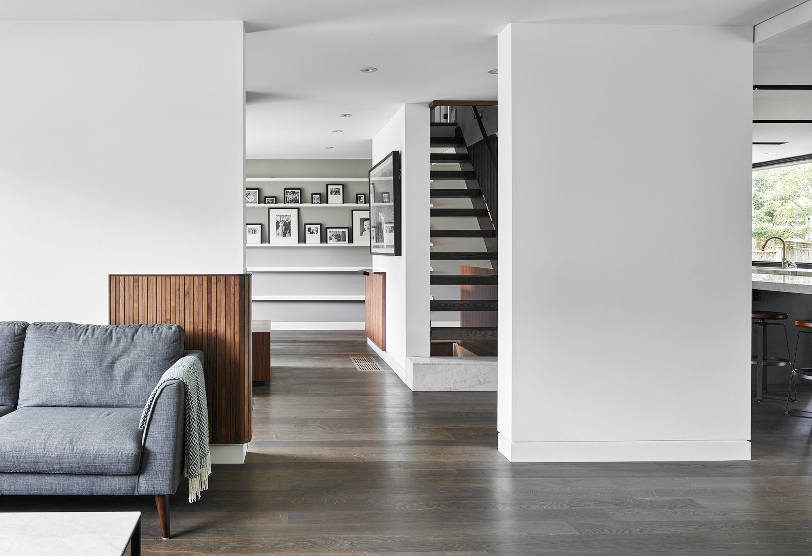 Tagged: Living Room, Sofa, Medium Hardwood Floor, Recessed Lighting, Coffee Tables, and Shelves.  Hibou House by Barbora Vokac Taylor Architect