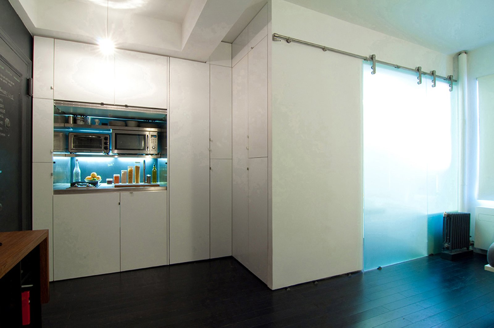 Tagged: Kitchen, White Cabinet, and Bamboo Floor.  Park Avenue Studio by Ajay Chopra
