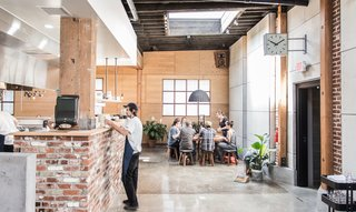 An Australian Cafe Filled With Handcrafted Details Comes to Portland, Oregon - Photo 2 of 7 - The serving line of Proud Mary's large, open kitchen was created using handmade maple shelves and the building's original 1920s brick.