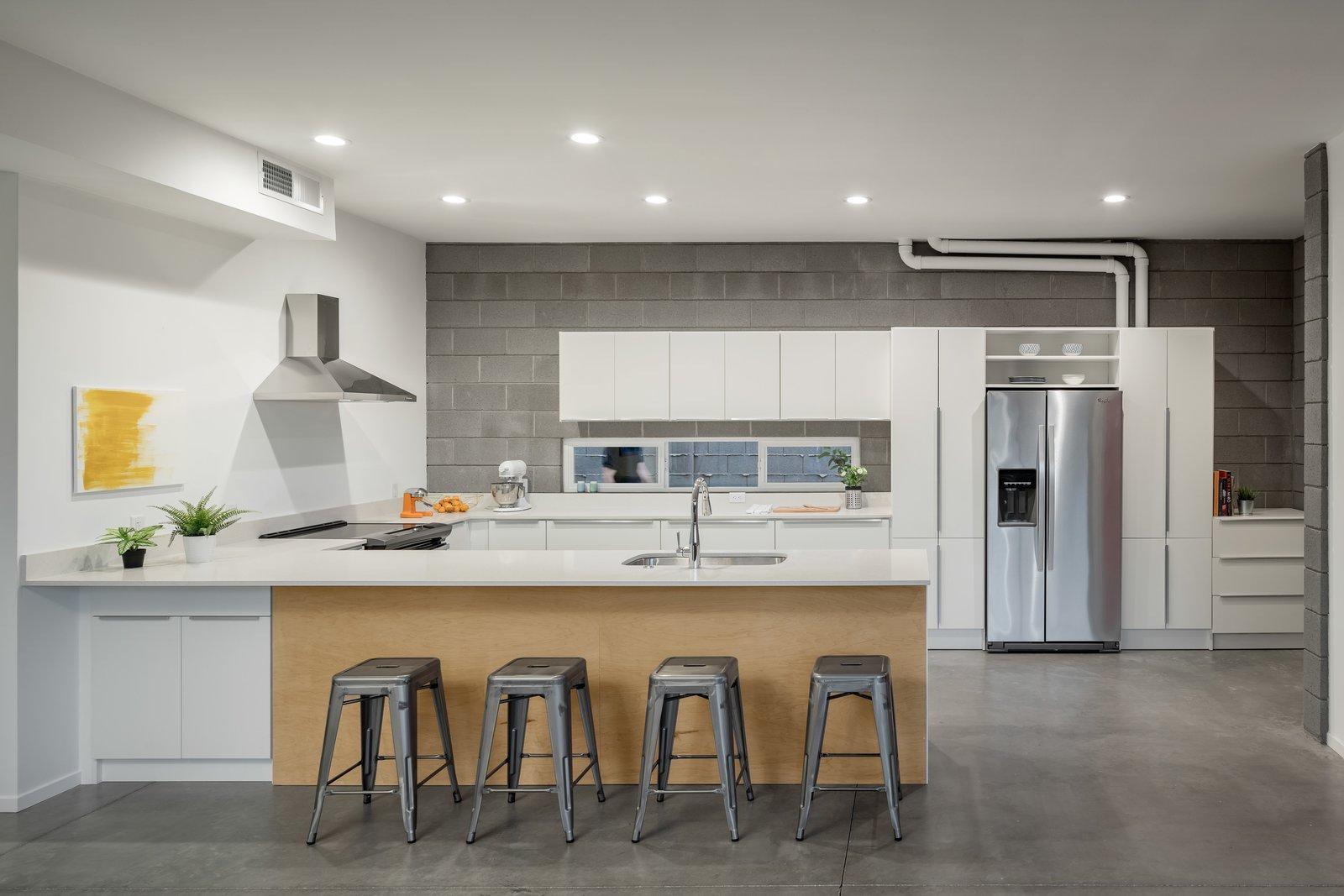 Tagged: Kitchen, White, Quartzite, Concrete, Recessed, Refrigerator, Range Hood, Undermount, and Range.  Best Kitchen Refrigerator Quartzite Photos from The Fillmore Duplex