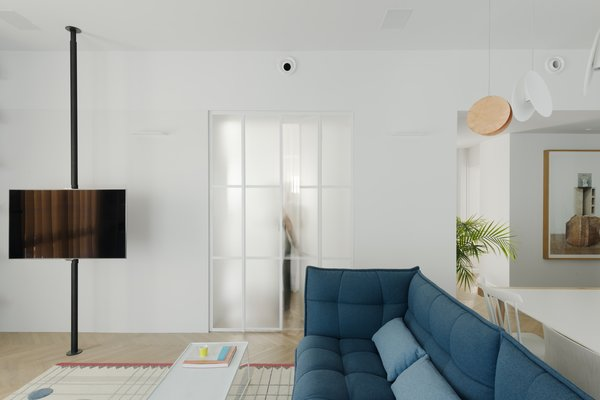 entrance to the master bedroom through safety-wired glass doors divided by stone-white colored Belgium profiles , maintaining the 1930's architecture heritage of the building.
