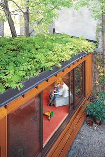 4 Easy Steps to Creating Your Own DIY Green Roof - Photo 2 of 6 - At Paul Bernier and Joëlle Thibault's home in Montreal, a green roof helps make up for lost garden space and creates a beautiful leafy view from the second and third floors. In summer, when the sliding doors are left wide open, indoor and outdoor spaces blend together.