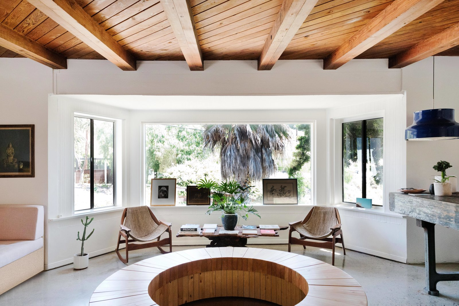 The rooms were designed to echo the region's bungalow-style homes with simple midcentury elements. Each of the 13 rooms feature exposed white wood beams and offer private patios with handmade hammocks. Bed frames by Design Within Reach host Casper mattresses where guests can rest their heads after a long day of surf and sun. Tagged: Living Room, Sofa, Pendant Lighting, Chair, Coffee Tables, and Terrazzo Floor.  Best Photos from Do Malibu in Style With the Native Hotel, a Rejuvenated Hollywood Favorite