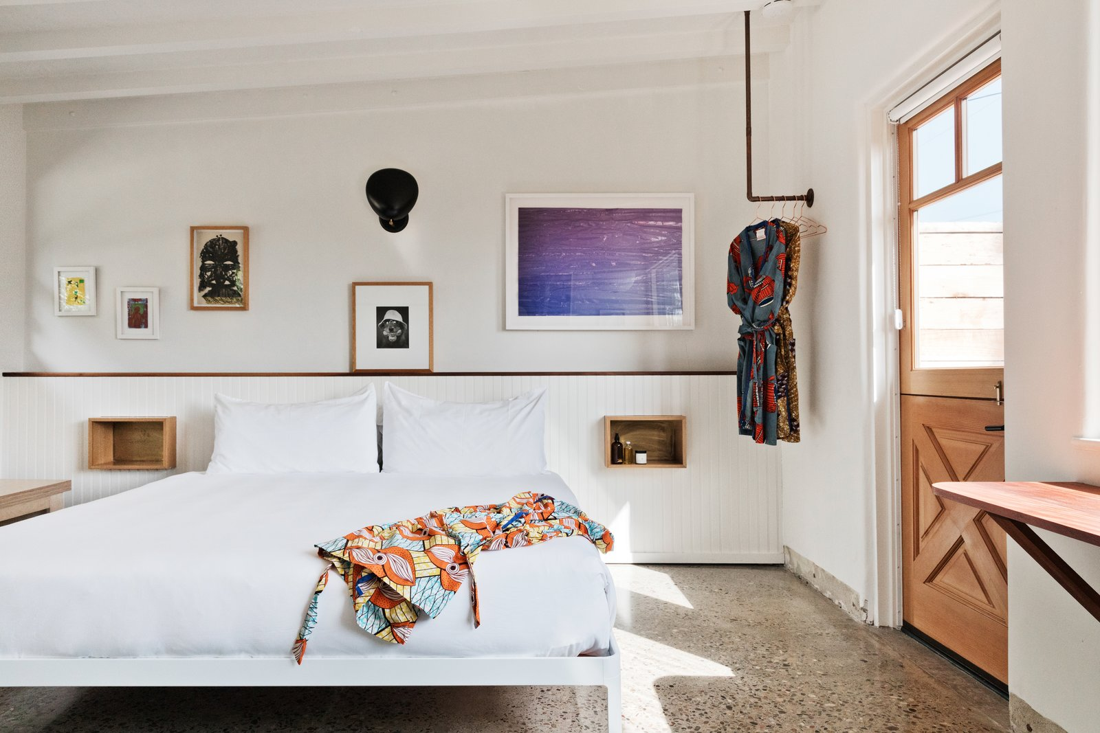 As if you needed another excuse to visit Malibu, Native beckons as a stylish getaway with a storied past. Rooms start at $400 a night. Tagged: Bedroom, Bed, Wall Lighting, Shelves, and Terrazzo Floor.  Best Photos from Do Malibu in Style With the Native Hotel, a Rejuvenated Hollywood Favorite
