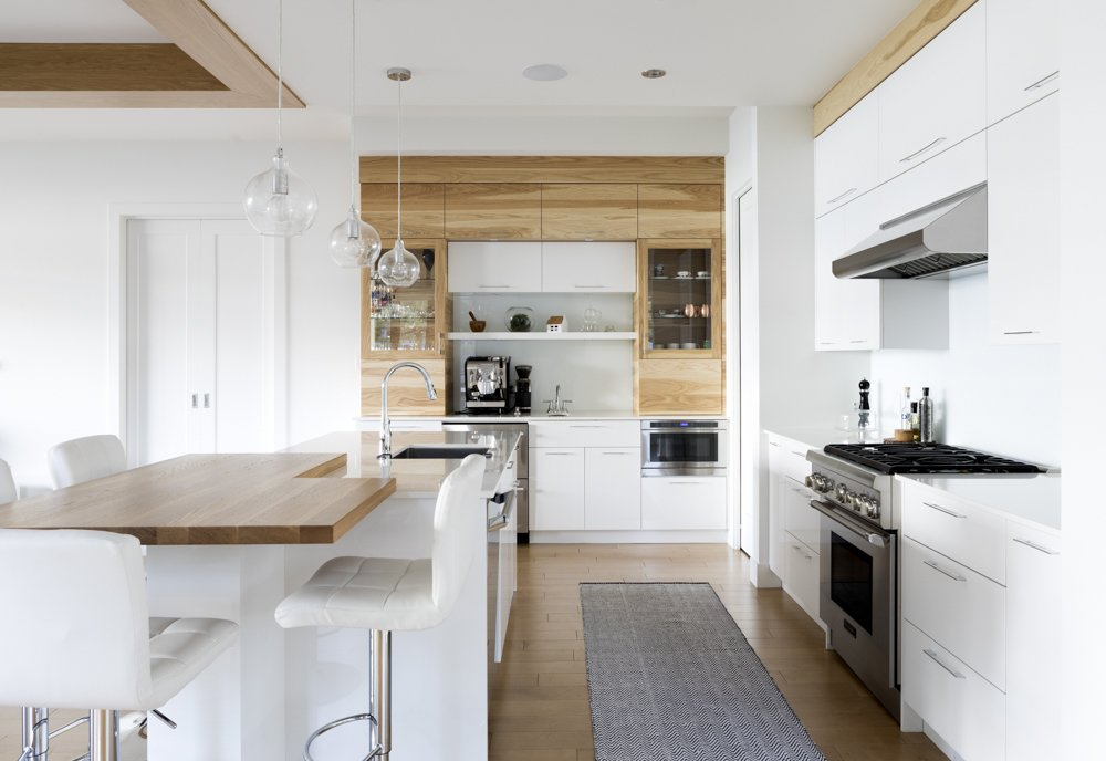 Tagged: Kitchen, Laminate, White, Laminate, Light Hardwood, Wood, Glass Tile, Ceiling, Pendant, Microwave, Wall Oven, and Drop In.  Best Kitchen Light Hardwood Drop In Photos from Résidence Léger