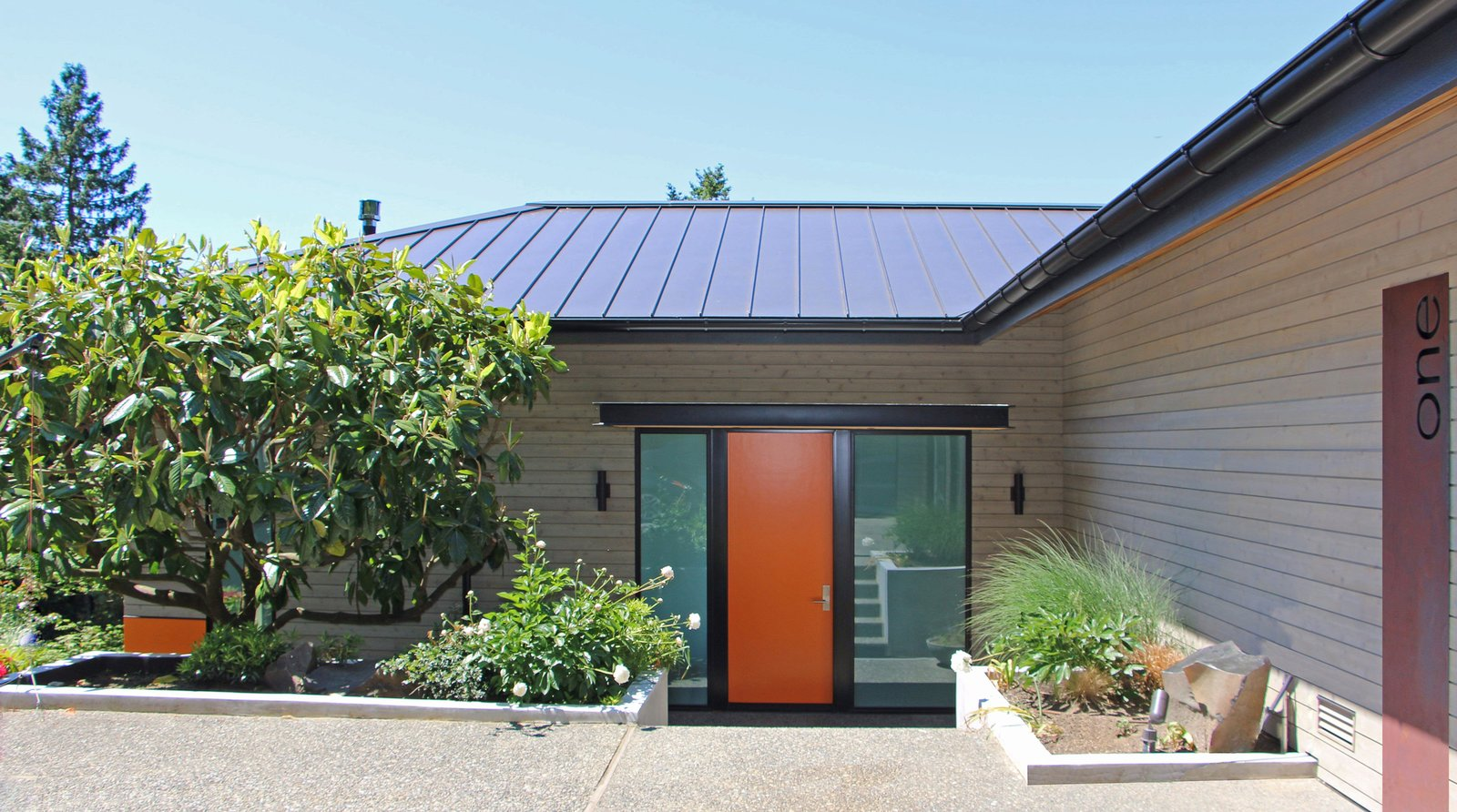 Brook Bay Front Entry Tagged: Exterior, House, Metal Roof Material, Wood Siding Material, and Hipped RoofLine.  Brook Bay Remodel by allison hogue