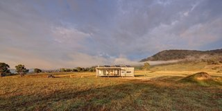 An Off-the-Grid Prefab in Australia Uses Salvaged Iron as Camo - Photo 1 of 4 -