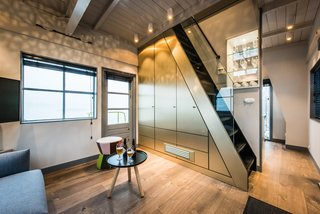 Elevate Your Next Amsterdam Experience With This Unique Crane Rental - Photo 2 of 13 - Timber floors add warmth to the compact apartment.
