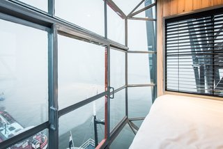 Elevate Your Next Amsterdam Experience With This Unique Crane Rental - Photo 13 of 13 - This top-level bedroom boasts spectacular views, thanks to the fully glazed walls and floor-to-ceiling windows.