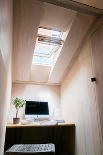 """A Quirky Micro-Office Hides Behind a """"Hairy"""" Facade - Photo 7 of 11 - The interior is illuminated by an illuminating sky light."""
