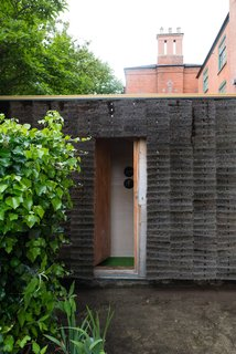 """A Quirky Micro-Office Hides Behind a """"Hairy"""" Facade - Photo 4 of 11 - The hidden entrance slides open."""