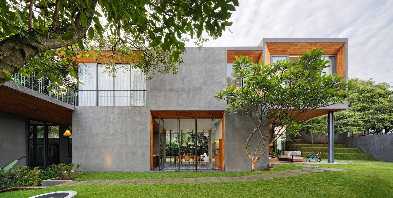 The concrete cladding contrasts with warm orange teak.